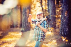 Free Old Bearded Man Outdoors. Portrait Of Aged Man With Beard. Smiling Old Man With Axe. Hiking In Deep Wood. Funny Forester Stock Photo - 191861490