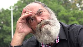 Old Bearded Man Thinking. Stock video of old bearded man thinking stock footage
