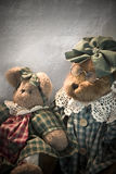Old bears. Old teddy bears sitting on a chair in soft light Royalty Free Stock Photography