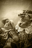 Old bears. Old teddy bears sitting on a chair in soft light Royalty Free Stock Image