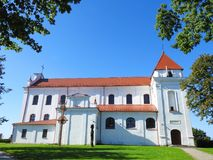 Old beautiful catholic church, Lithuania. Raseiniai Assumption of the Blessed Virgin Mary Church, Lithuania. Build in 1663, reconstruction in 1776 - 1783 Stock Photos