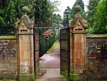 Old, beautiful gate leading to the garden Royalty Free Stock Image