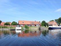 River Minija , ships and homes, Lithuania Royalty Free Stock Photos