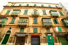 An old beautiful house in the centre of the capital city Valetta in Malta. An old beautiful house in the center of the capital city Valetta in Malta Royalty Free Stock Image