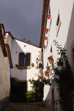 Old beautiful houses in medieval city of Obidos, Portugal Stock Photos