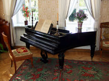 Old beautiful piano. Old piano in beautiful room, old classical style Royalty Free Stock Photo