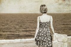 Beautiful pregnant girl at sea background. A old Beautiful pregnant girl at sea background royalty free stock image