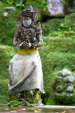 Old beautiful stone Balinese statue Stock Photography