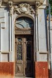 Old beautiful vintage wooden door of noble mansion.  Stock Photos