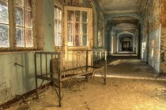 Old bed in an abandoned hospital Royalty Free Stock Image