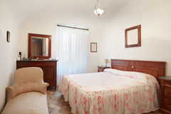 Old bedroom with queen size bed in ancient interior Stock Image