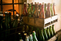 Old beer bottles in wooden cases Stock Image
