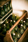 Old beer bottles in wooden cases Royalty Free Stock Images