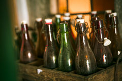 Old beer bottles in wooden cases Royalty Free Stock Photos