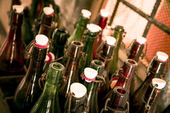 Old beer bottles in wooden cases Stock Photo
