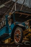 Old beer truck standing in a factory hall of a brewery royalty free stock photography