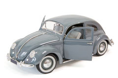 Old beetle. Grey beetle as model car on white background Stock Image