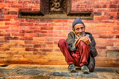 Old beggar in the street of Kathmandu, Nepal Stock Photos