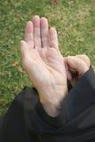 An old begging woman Stock Photos