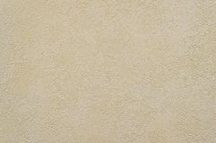 Old beige concrete wall background texture. Close up Royalty Free Stock Photography