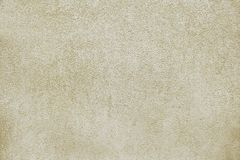 Old beige concrete wall background texture. Close up Stock Photos