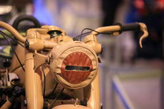 Old beige motorcycle closeup Stock Image