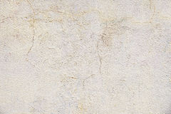 Old beige painted wall background texture. Close up Royalty Free Stock Photo