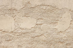 Old beige painted wall background texture. Close up Royalty Free Stock Image