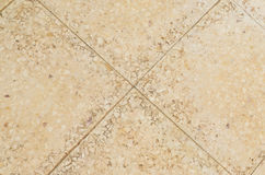 Old beige stone floor tiles Royalty Free Stock Photo