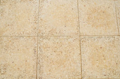 Old beige stone floor tiles Royalty Free Stock Images