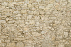 Old beige stone wall background