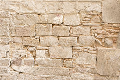 Old beige stone wall background texture Royalty Free Stock Image