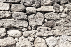 Old beige stone wall background texture close up. Stock Photography