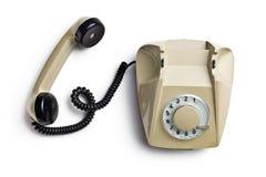 Old beige telephone Stock Photo
