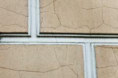 Old beige wall with cracks Stock Image