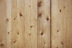 Old beige wooden fence background texture. Close up Stock Image