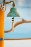 Old bell on board Stock Image