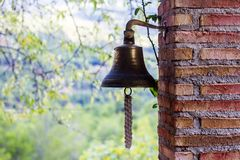 Old bell in a brick column stock photos