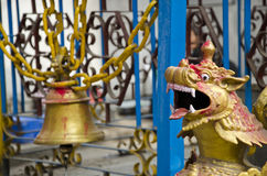 Old bell and dragon head in asia temple, Nepal Stock Images
