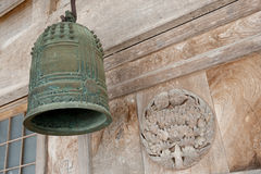 Old bell, front of Shinto temple, Japan. An old copper bell in front of Japanese Shinto temple, Ainokura, Gifu Prefecture Royalty Free Stock Photos