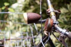 Old bell ringer on handle bar of bicycle. Royalty Free Stock Images