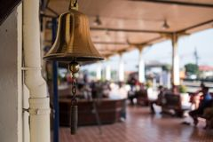 The old bell rings in train station in Thailand. The old bell rings in train station. to alarm people about coming train in northern Thailand Royalty Free Stock Photo