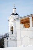Old bell tower in Kolomenskoye park in winter. Stock Photo