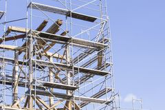 The old bell tower. Restoration of the old bell tower. Scaffolding Royalty Free Stock Photos