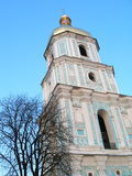 Old bell tower of St. Sophia Cathedral in Kiev. On a background of blue sky stock photos