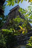 Old bell tower among the trees Royalty Free Stock Photo