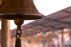 Old bell in train station. With sunrise light Stock Image