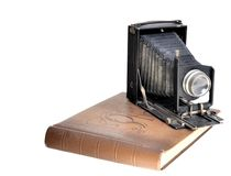 Old bellows camera. And photo albium Royalty Free Stock Images