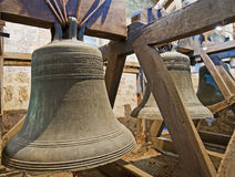 Old bells in a church tower. Traditional old bells in a church tower from the middle ages Stock Photo