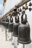 Old bells at the Golden Mount in Bangkok. Many old Buddhist steel bells at the Golden Mount at Wat Saket in Bangkok, Thailand, on a sunny day Stock Photo
